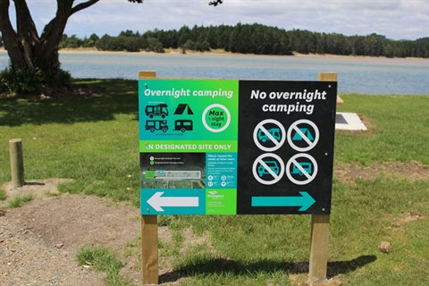 Photo of Whangarei District Council freedom camping signs at a beach.